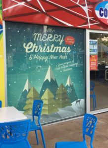 Commercial office fit out using Xmas themed custom printed window roller blinds